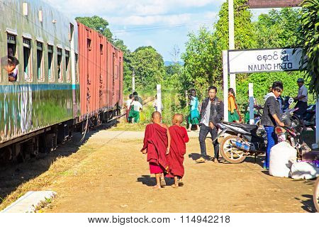 BAGO, MYANMAR - November 16, 2015: Passengers leaving  the train in Bago Myanmar.The quality of the railway infrastructure is generally poor.