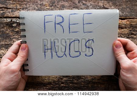 Man Holding A Sign Free Hugs The International Day Of Hugs