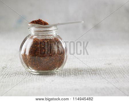 coarse chilli in the glass container