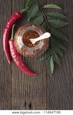 curry leaf,coarse chili powder on the wooden background
