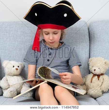 Little Girl In Pirate Costume Reading Book With Her Plush Friends.