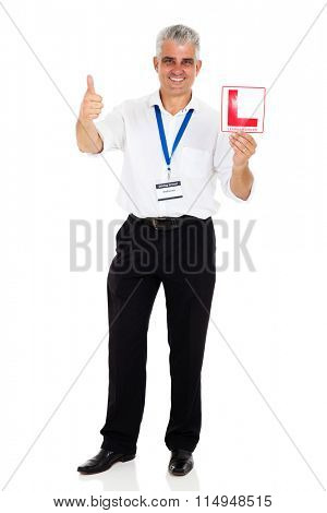 portrait of professional senior driving instructor holding L sign
