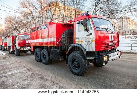 Red Firetrucks Kamaz-43114 Speeding Down A Street To A Call In Samara, Russia