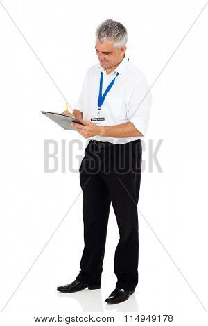 senior driving instructor writing on clipboard isolated on white background