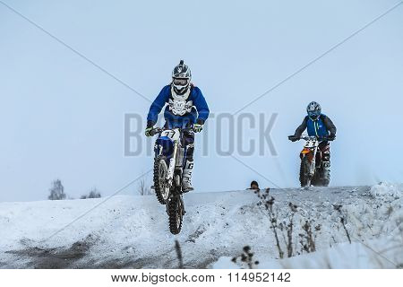 racer man on motorcycle flying over mountain after jump