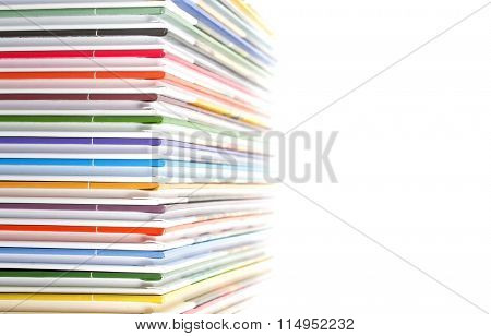 a stack of colorful books on white