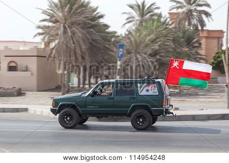 Car With A National Flag In Oman
