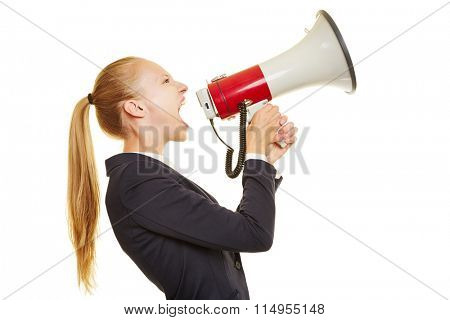 Young blonde businesswoman screaming loudly into a megaphone