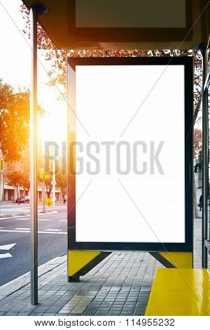 Empty lightbox on the city bus stop. Vertical. Mockup