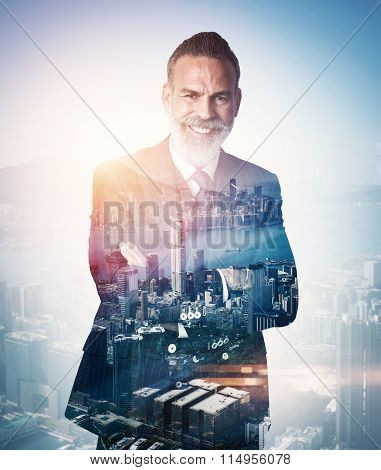 Portrait of bearded businessman smiling. Double exposure city on the background. Vertical