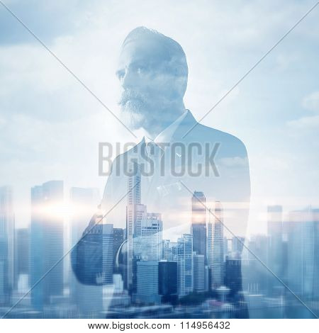 Portrait of stylish gentleman. Double exposure city on the background. Visual effects.