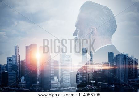 Double exposure of stylish businessman and contemporary city on the background. Horizontal, close-up