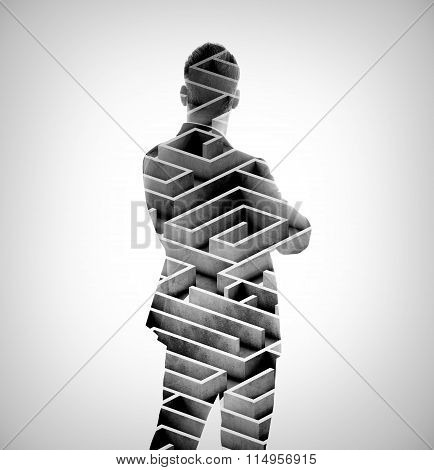 Double exposure of stylish businessman and labyrinth on the background. Isolated