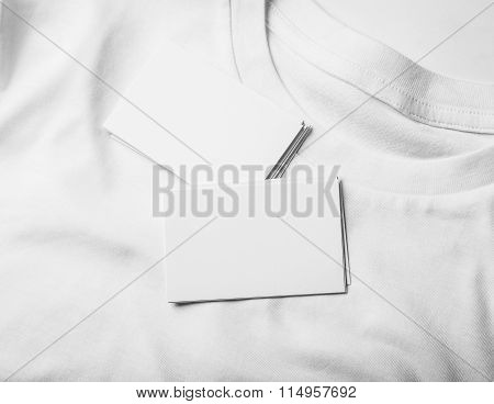 Closeup of blanks business cards on white tshirt