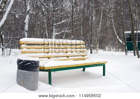 Yellow Bench And Trashcan In Winter