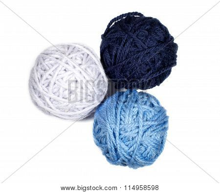 Three Skeins In Blue Tones Over White