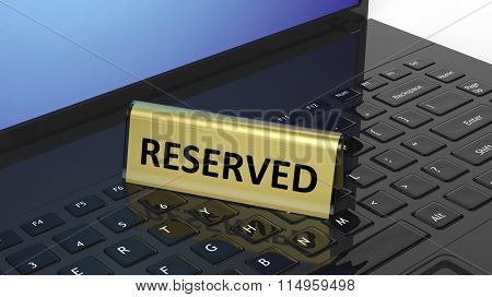 Golden glossy reservation sign on laptop keyboard, isolated on white background.