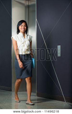 Pretty Smiling Businesswoman Walking Office