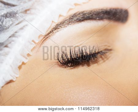 Beautiful young woman eyelash extension making process