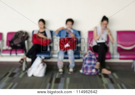 Passengers In Waiting Waiting Room At Airport On Blur Background
