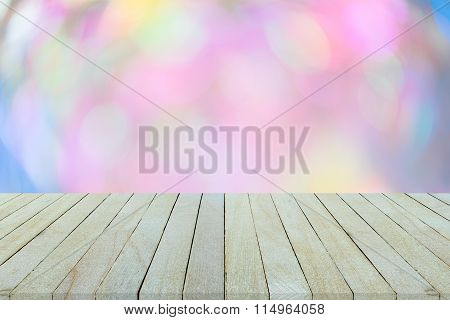 Empty Top View Of Wooden Table Or Counter On Colorful Bokeh Background.