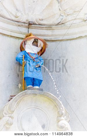 BRUSSELS, BELGIUM - 11 AUGUST, 2015: Manneken Pis famous landmark bronze statue showing little boy p