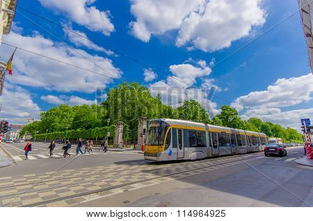 BRUSSELS, BELGIUM - 11 AUGUST, 2015: Blue tram passing by Palace of the Nation on a beautiful sunny