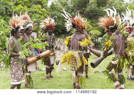 Tribal warriors and women dressed in native clothes