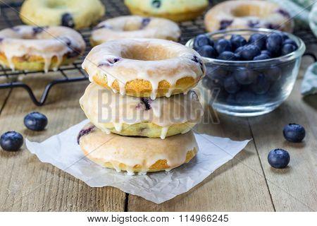 Freshly Baked Baked Doughnuts With Blueberries And Lemon Glaze, For Breakfast