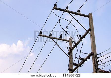 Electrical wires on blue sky background