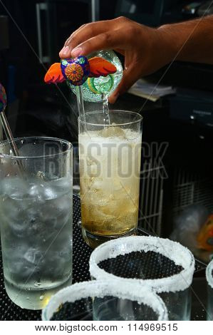 At the bar: serving beverage on the rocks