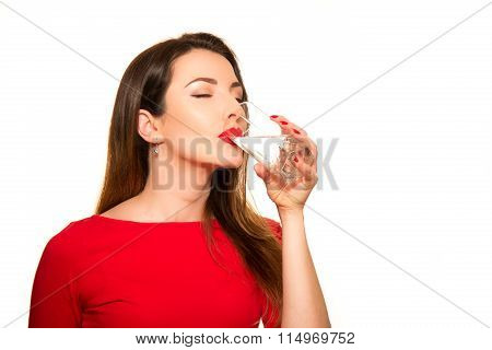Beautiful Girl Drinking A Glass Of Pure Water Smiling.closing Eyes