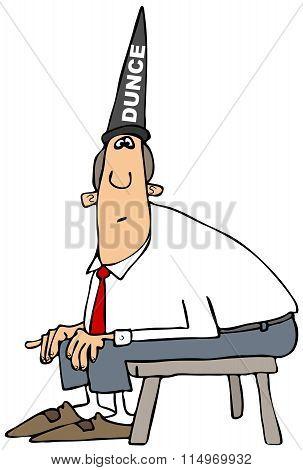 Dumb man wearing a dunce hat