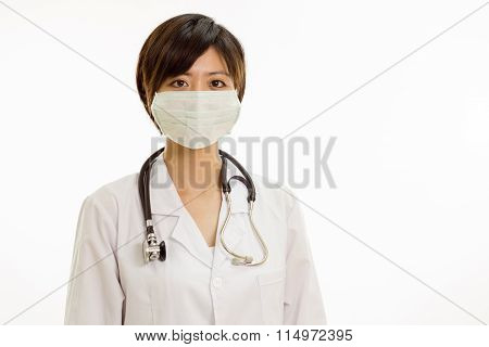 Asian Female Doctor With Surgical Mask Looking At Camera