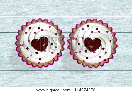 Two Cupcakes Lying On Wooden Desk