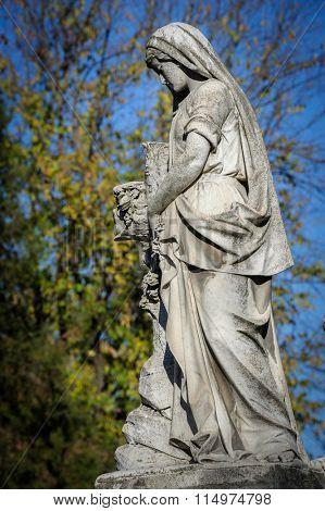 Stone cemetery statue