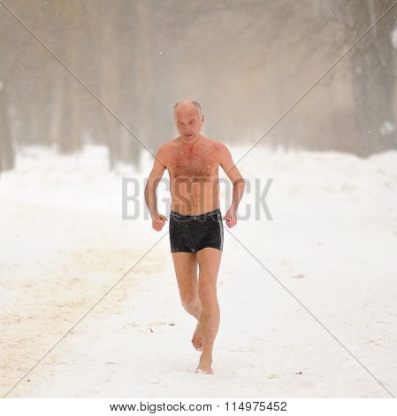 Orel, Russia - January 19, 2016: Russian Epiphany Feast. Man In Pants Running In Snowy Weather