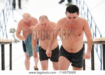 Orel, Russia - January 19, 2016: Russian Epiphany Feast. Three Man In Pants Going Up The Stairs