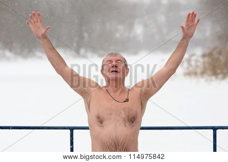Orel, Russia - January 19, 2016: Russian Epiphany Feast. Naked Man pray hands up
