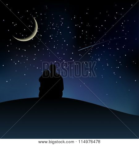 Black couple silhouettes sitting on the hill and watching starry sky