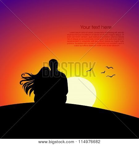 Black couple silhouettes in front of sunset background