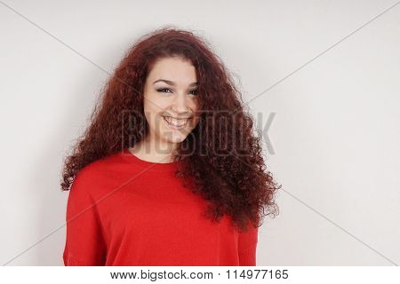 young woman with a toothy smile