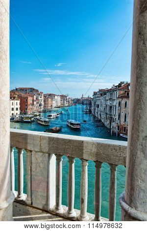 VENICE - AUGUST 27: Vaparetto water buses on the Grand Canal, Venice viewed from the stone balcony of one of the historic palaces overlooking the canal, bright sunny day. August 27, 2015 in Venice