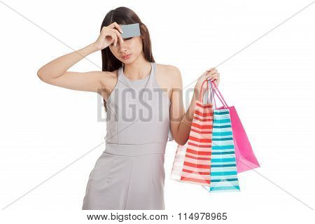 Unhappy  Young Asian Woman With Shopping Bags And Credit Card