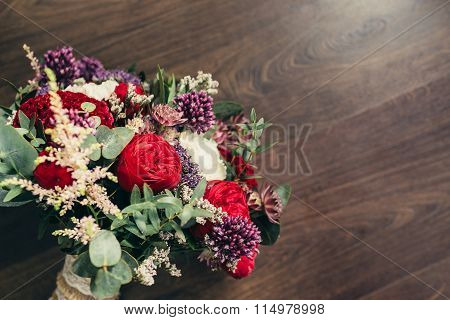 Rustic Wedding Bouquet With Red Rose And Lilac Flowers On Wooden Background