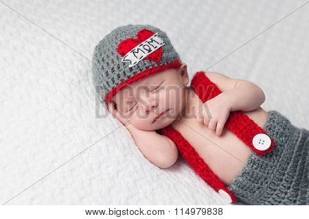Newborn Baby Boy Wearing A