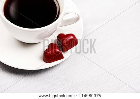 Cups of coffee and heart shaped sweets