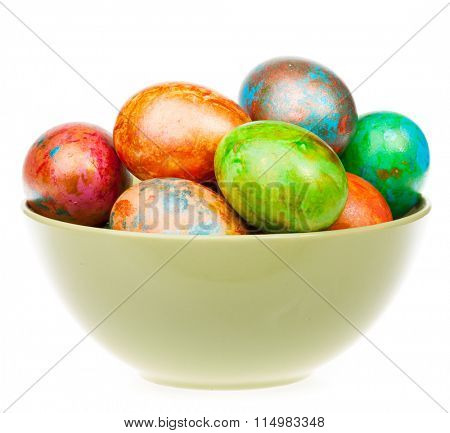 Colored easter eggs in a bowl on white background