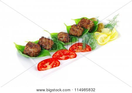 french beef meat cutlets and vegetables on white