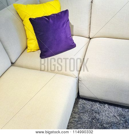 White Corner Sofa With Colorful Cushions